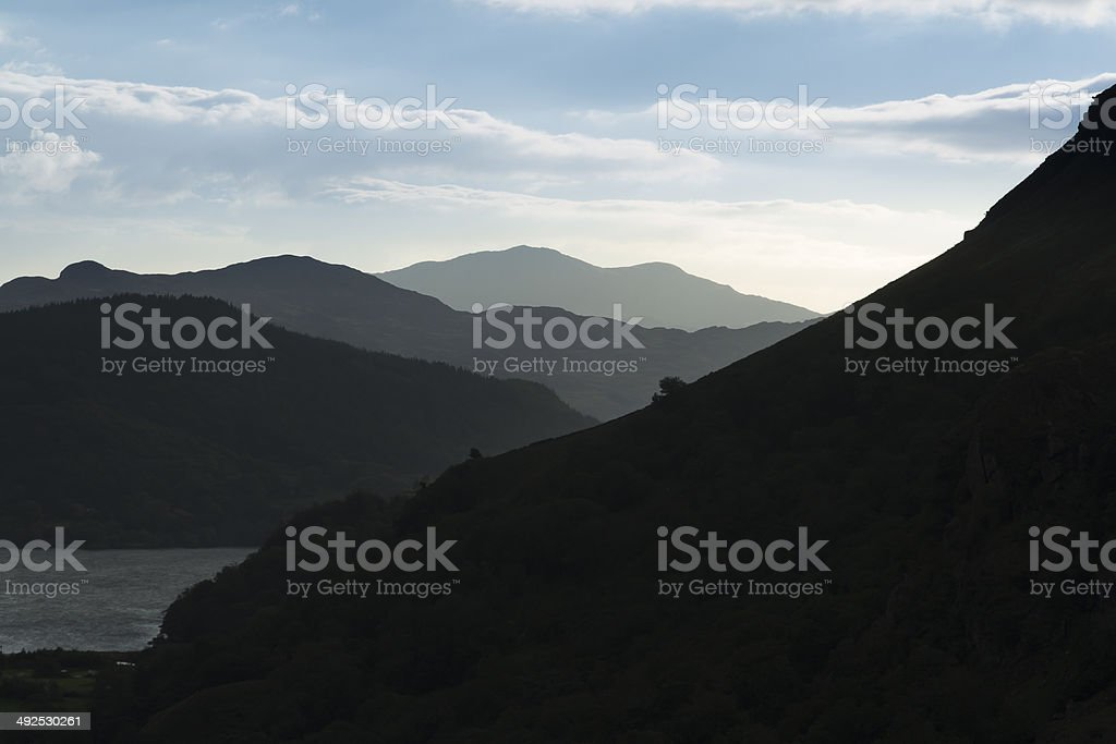 Twilight shaded grey mountains,  Silhouetted, Nant Gwynant Pass. stock photo