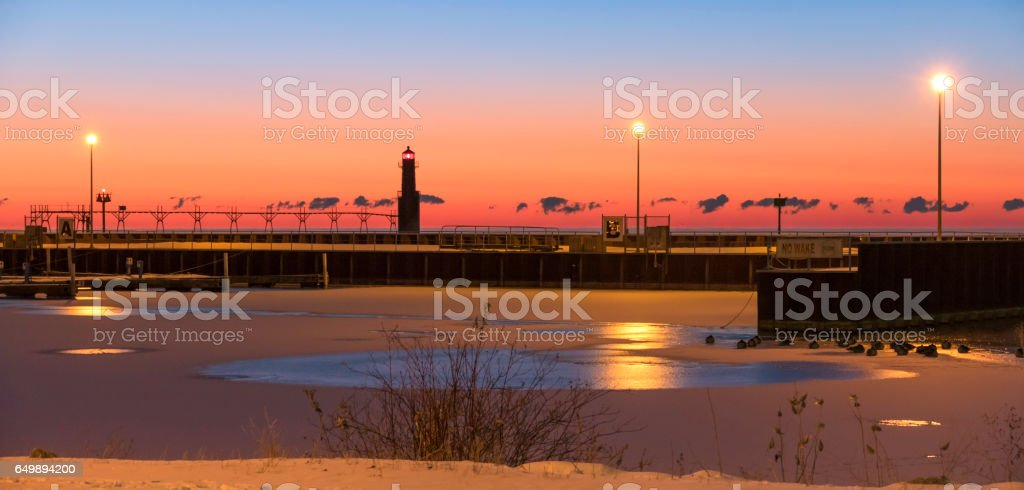 Twilight sky over cold harbor with stunning sky, lighthouse stock photo