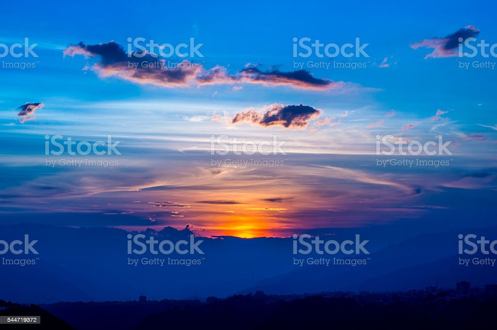 Twilight time,the blue sky with golden sunrise... stock photo