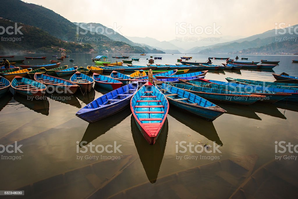 twilight with boats on Phewa lake, Pokhara, Nepal stock photo