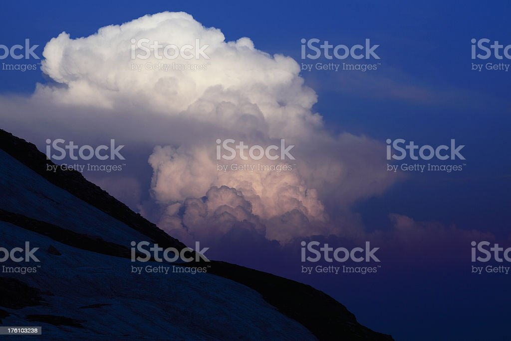 Twilight Zone Clouds over Snow covered Mountains royalty-free stock photo
