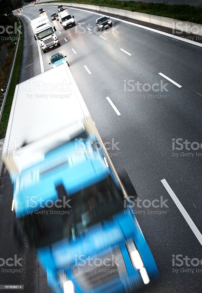Twillight on the freeway - Trucks on Highway stock photo