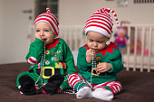 twin babies elf helper of Santa