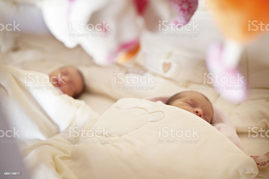 Twin babies in cot stock photo