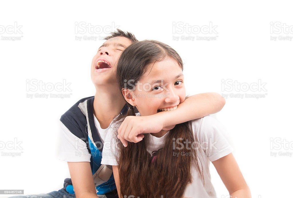 Twin brother and sister fighting bad mood stock photo