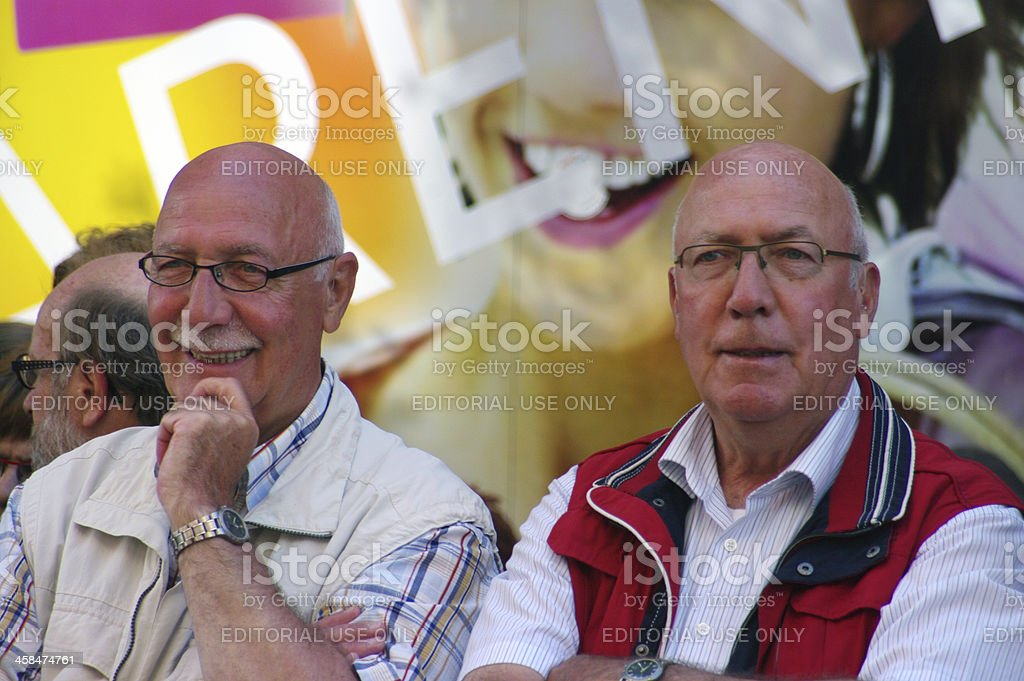 Twin brothers watching the music parade stock photo