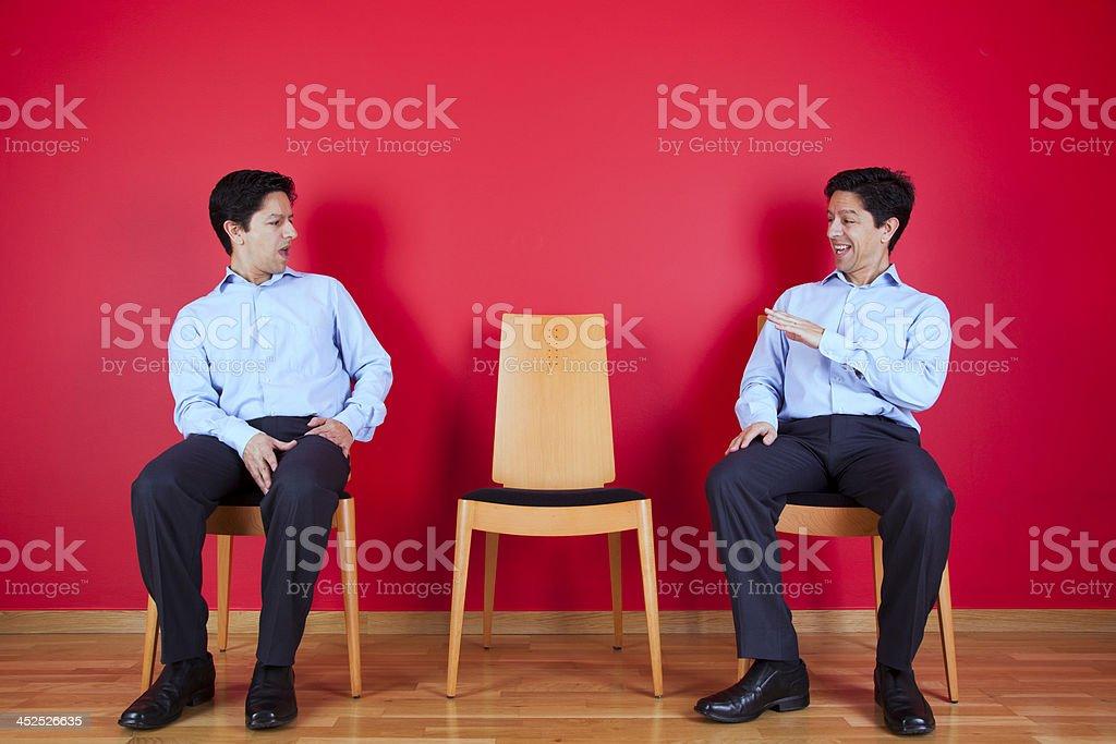 Twin businessman confrontation stock photo