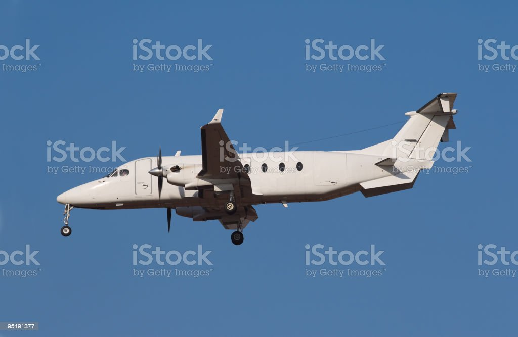 Twin engine light aircraft coming in to land royalty-free stock photo