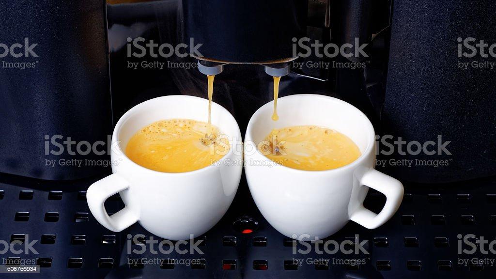 Twin espresso preparation in coffee machine stock photo