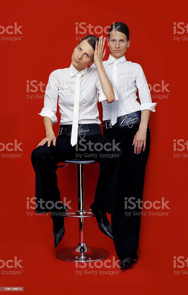 Twin girls dressed in men's clothes royalty-free stock photo