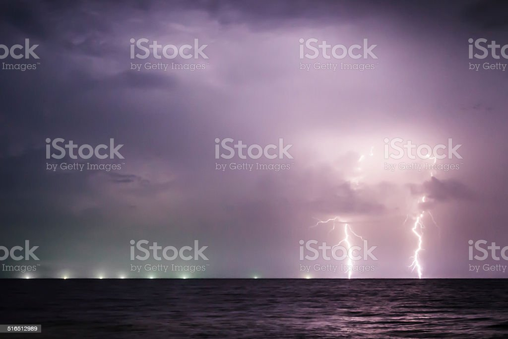 Twin Lightning Bolts on the sea stock photo