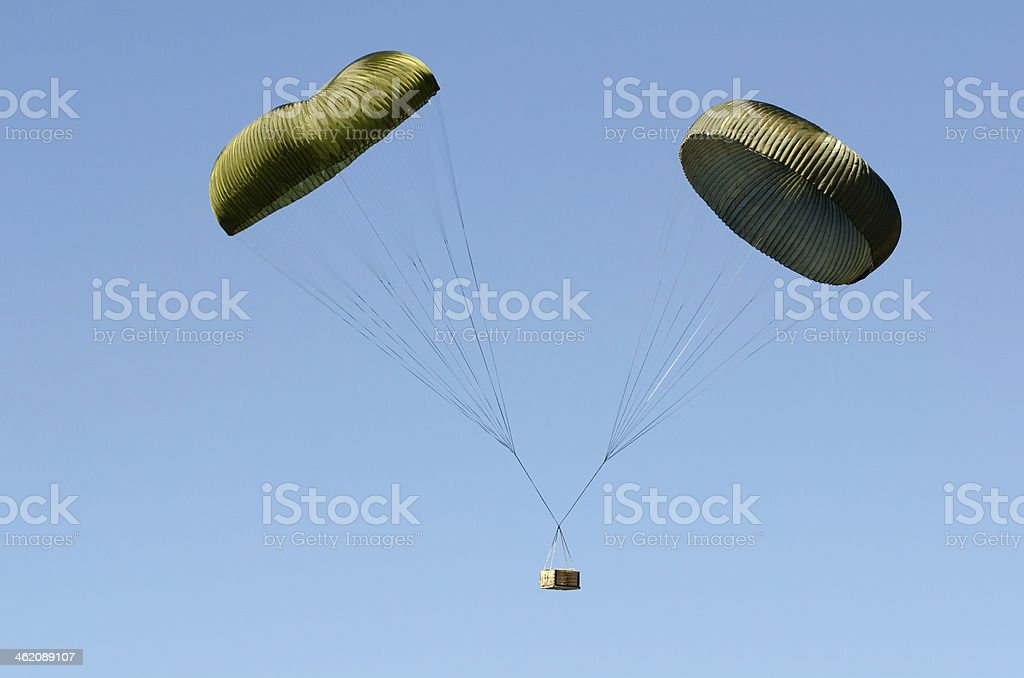 Twin parachute box drop stock photo