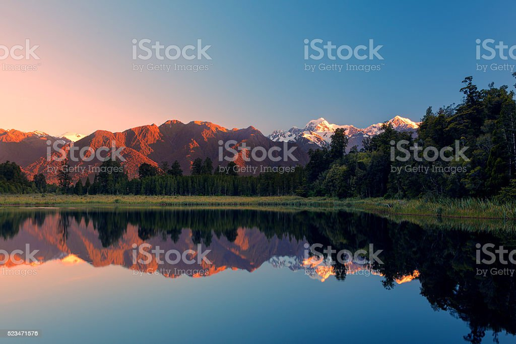 Twin Peaks reflect in the beautiful Lake Matheson, New Zealand stock photo