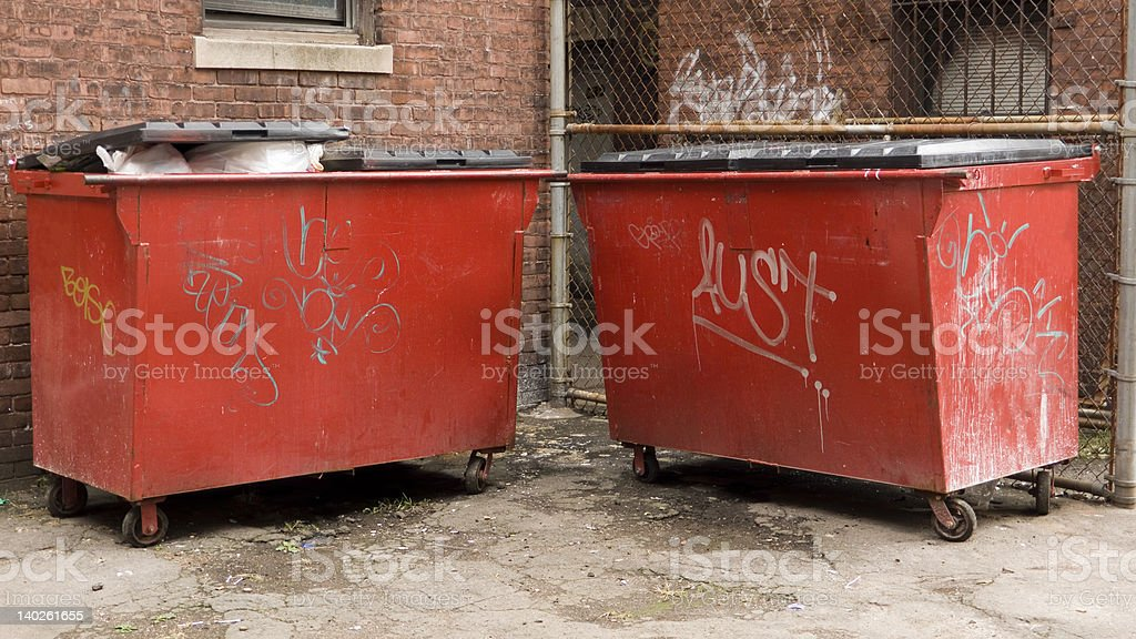 Twin Red Dumpsters stock photo