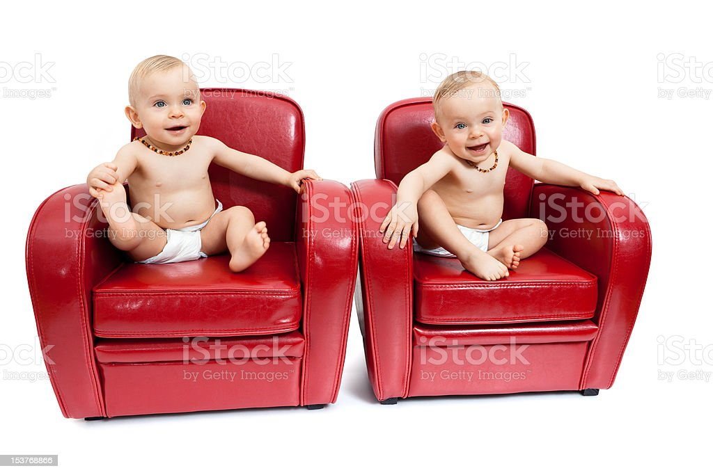 Twin sisters on armchairs. royalty-free stock photo