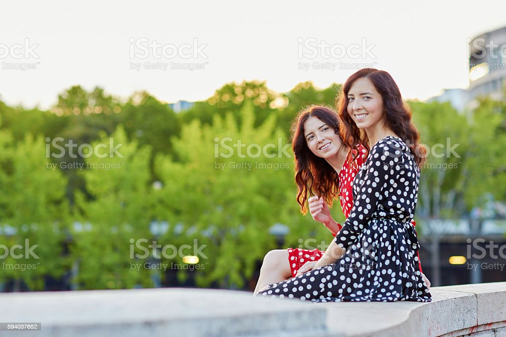 Twin sisters on the Bir Hakeim bridge in Paris, France stock photo