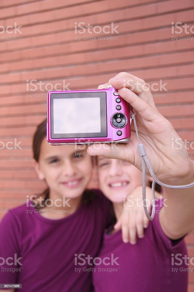 Twin sisters taking a photo stock photo
