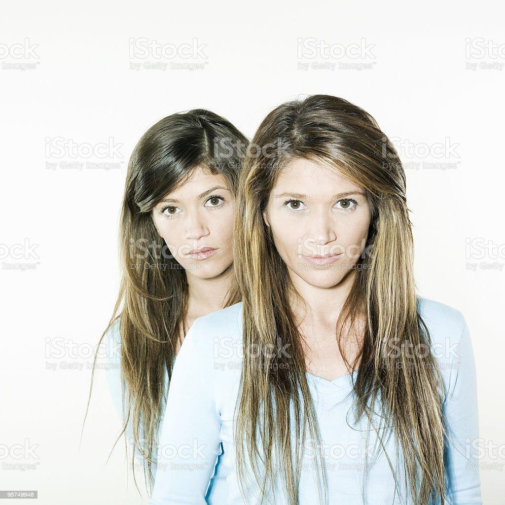 twin sisters woman portrait stock photo