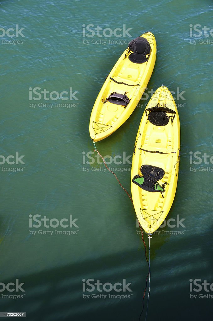 Twin yellow kayaks royalty-free stock photo