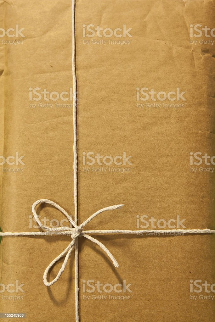 Twine Bow around a Classic Manila Envelope royalty-free stock photo