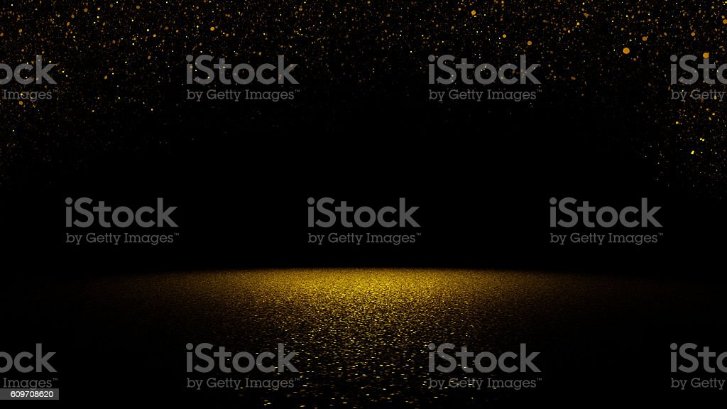 twinkling golden glitter falling on flat surface lit by spotlight royalty-free stock photo