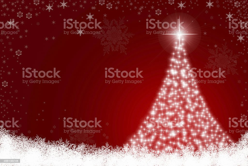 Twinkly Christmas Tree in Snow stock photo