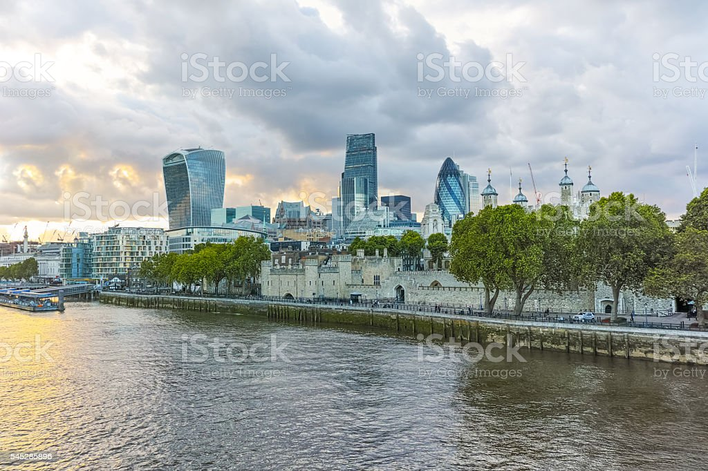 Twinlight cityscape of City of London and Thames River, England stock photo