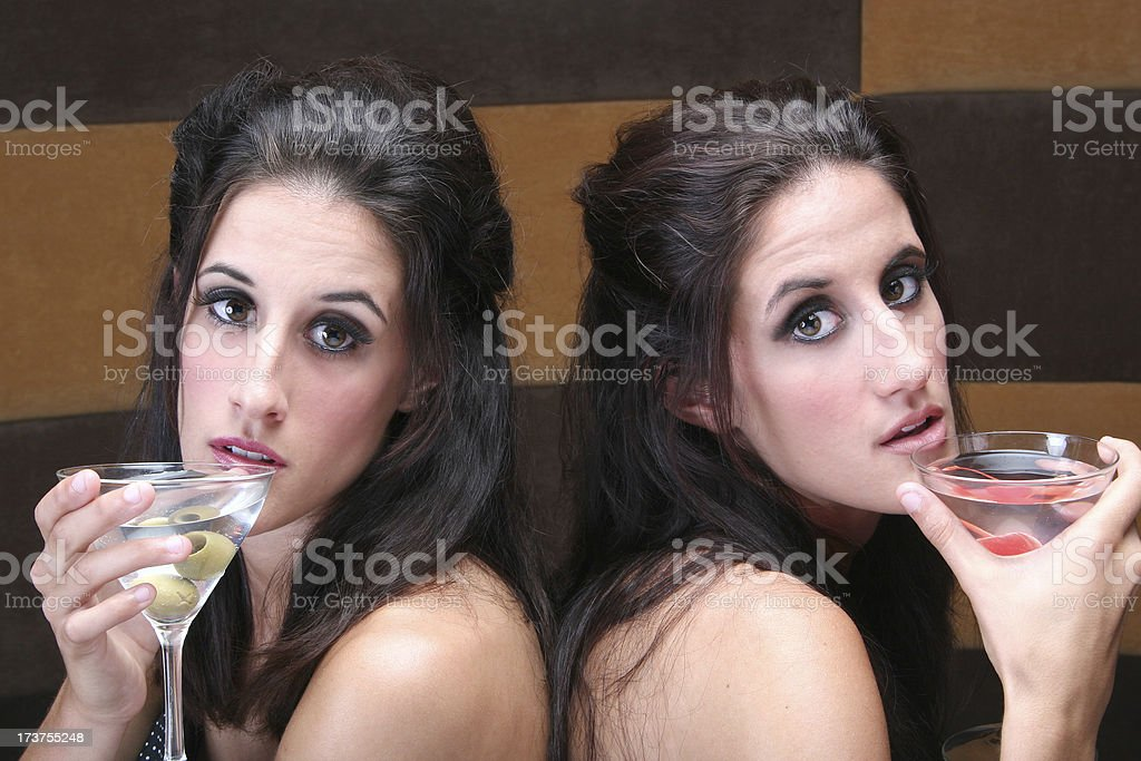 Twins and cocktails. royalty-free stock photo