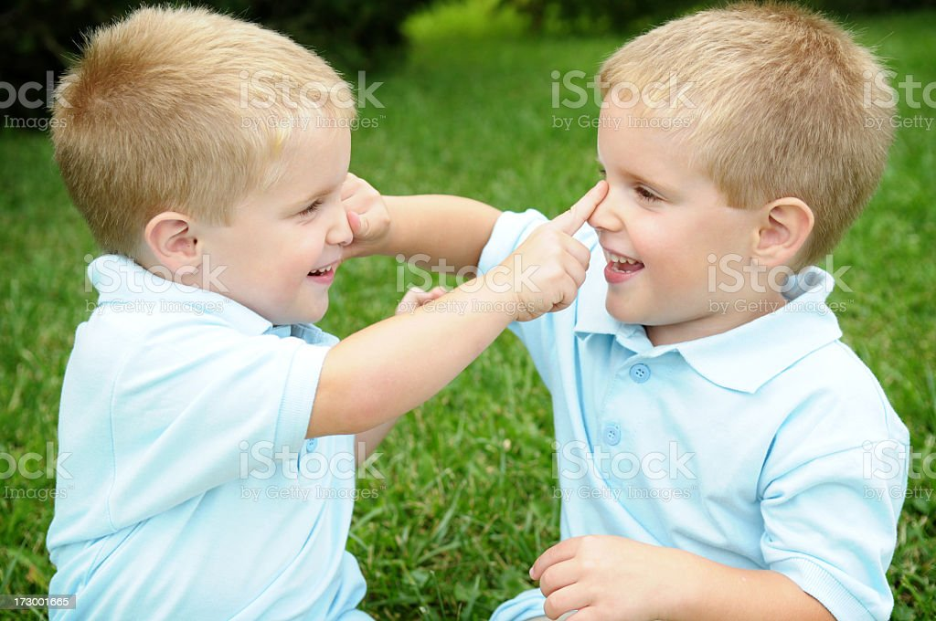 Twins Boys Playing Together Outside stock photo