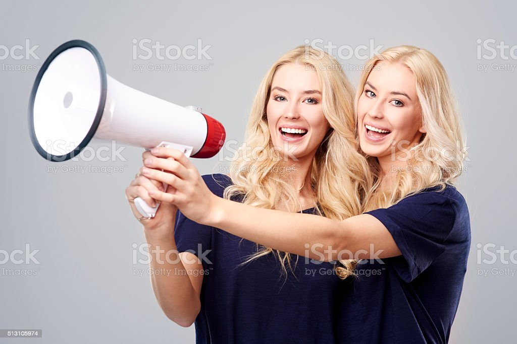 Twins have good news for you stock photo
