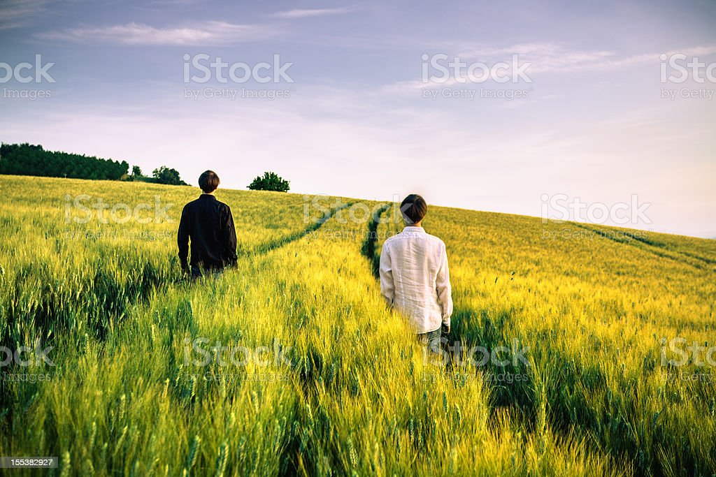 Twins in Wheat Field with Tracks stock photo