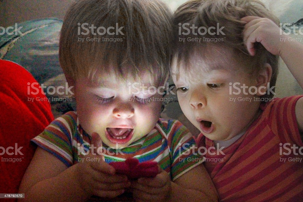 Twins surf the Net stock photo