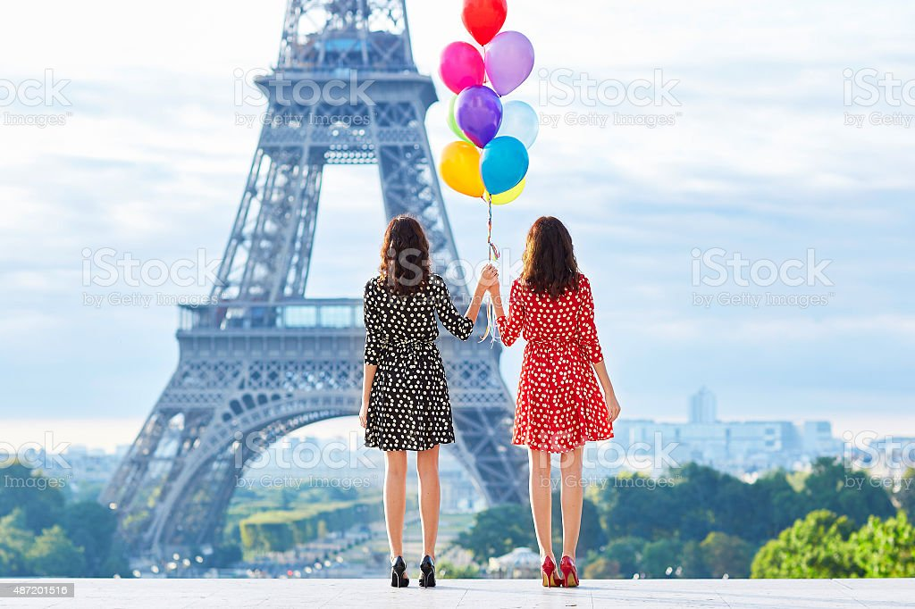 Twins with colorful balloons in Paris stock photo