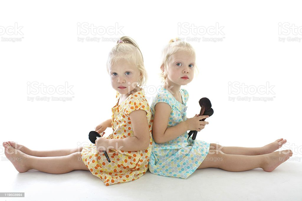 twins with make-up brushes royalty-free stock photo