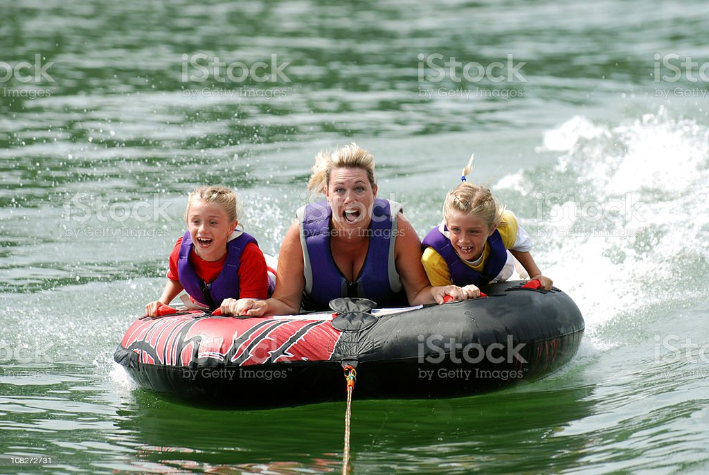 Twins with Mom Riding Tube royalty-free stock photo