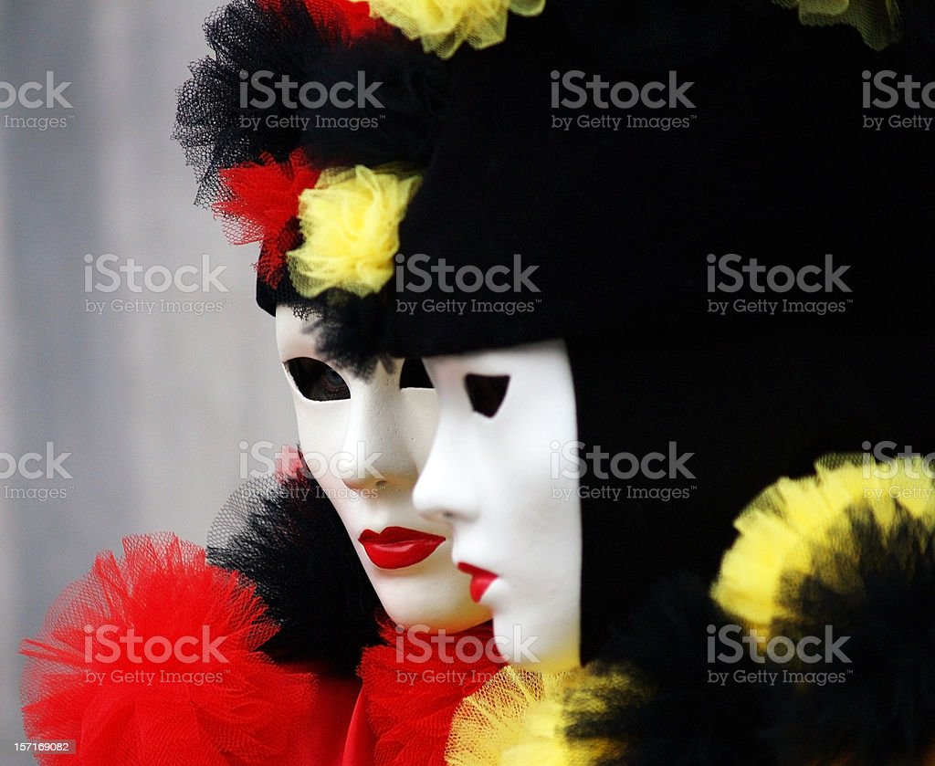 Twins; yellow & red; Carnival in Venice stock photo