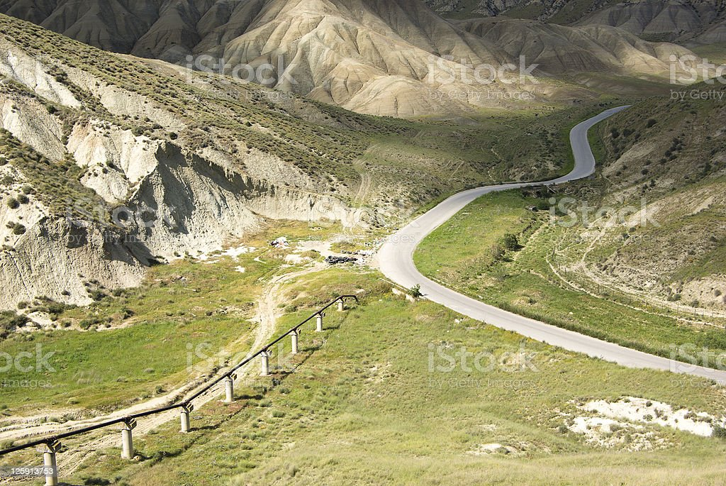 twist road between green hills royalty-free stock photo