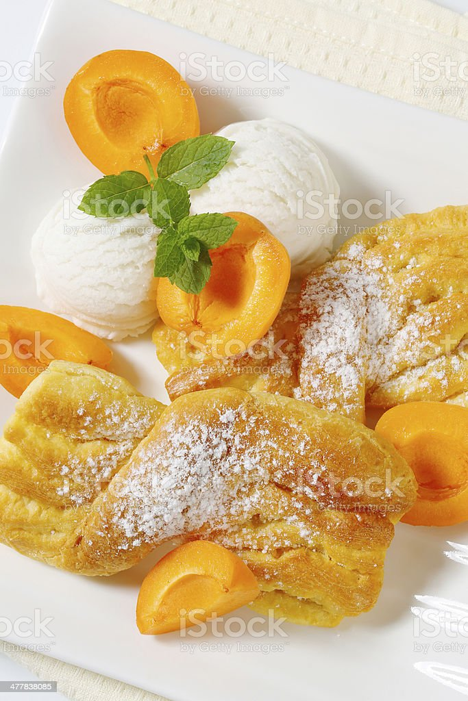 twisted cakes, ice cream and apricots royalty-free stock photo