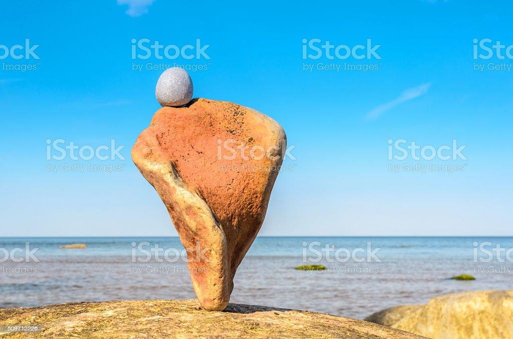 Twisted orange stone stock photo