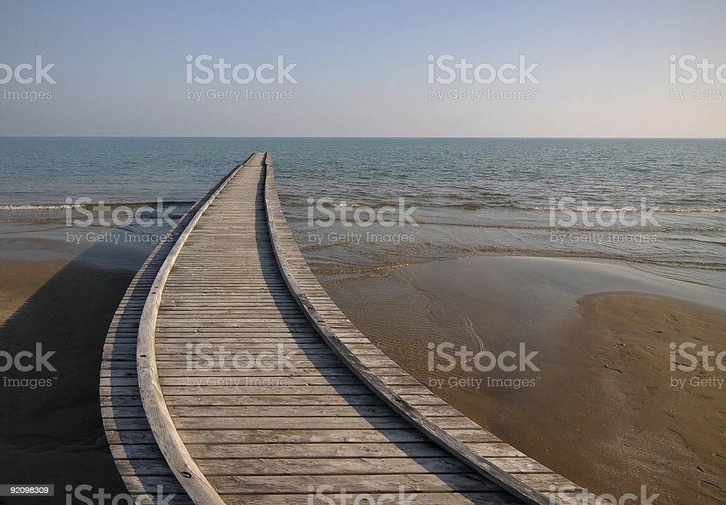 Twisted path to the sea stock photo