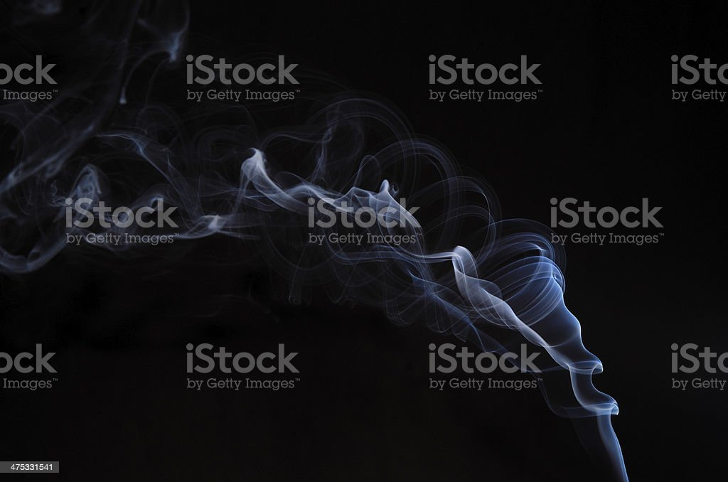 twisted smoke on black stock photo