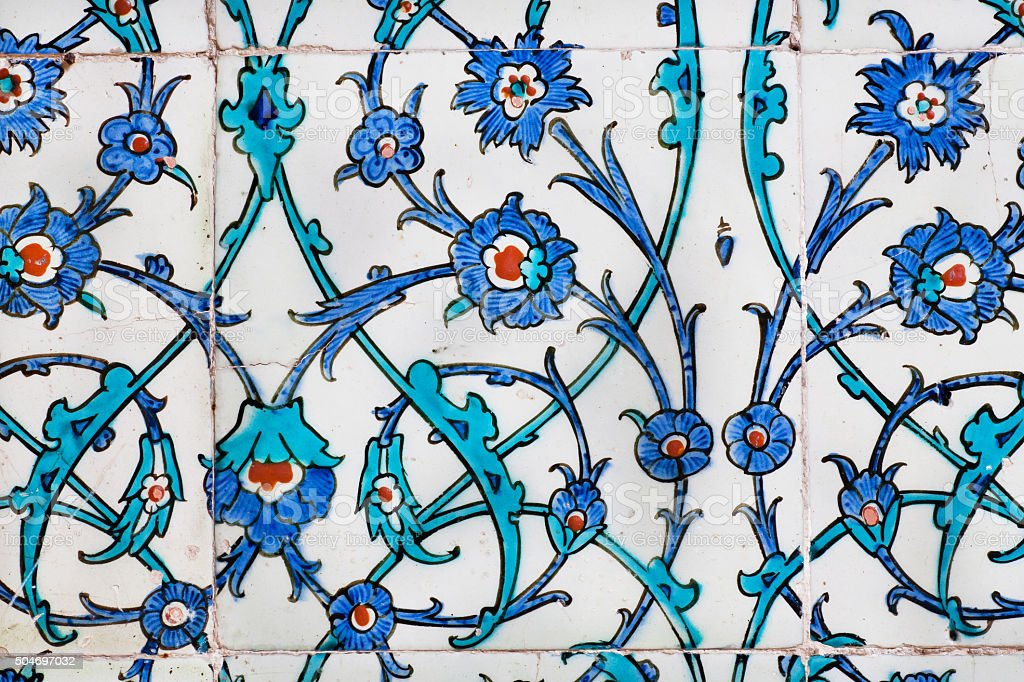 Twisted stems of the flowers on vintage tiles stock photo