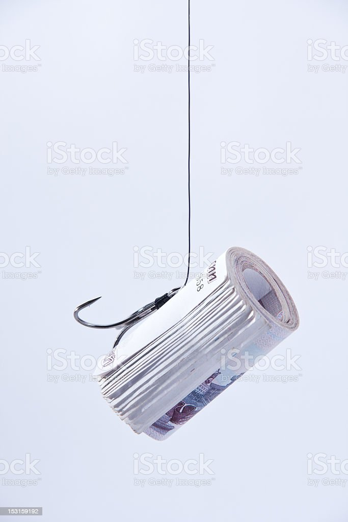twisting banknotes hanging on a hook royalty-free stock photo