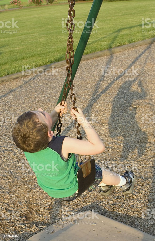 Twisting on the Swing stock photo