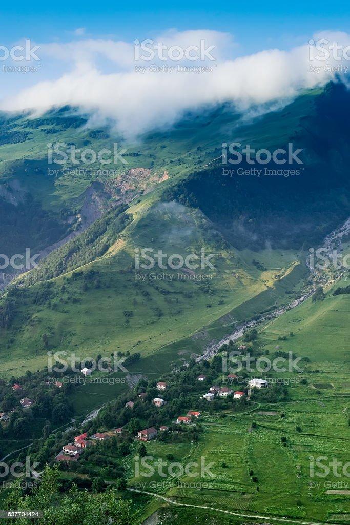 Twisty river in mountain village in Georgia stock photo