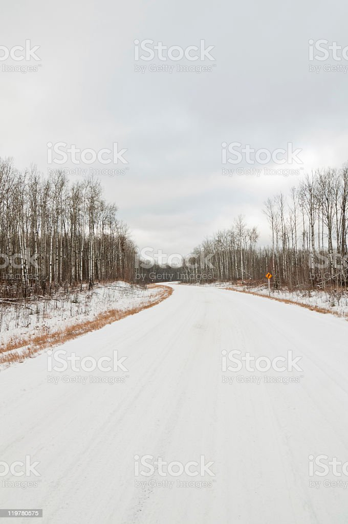 Twisty winter road covered in snow royalty-free stock photo