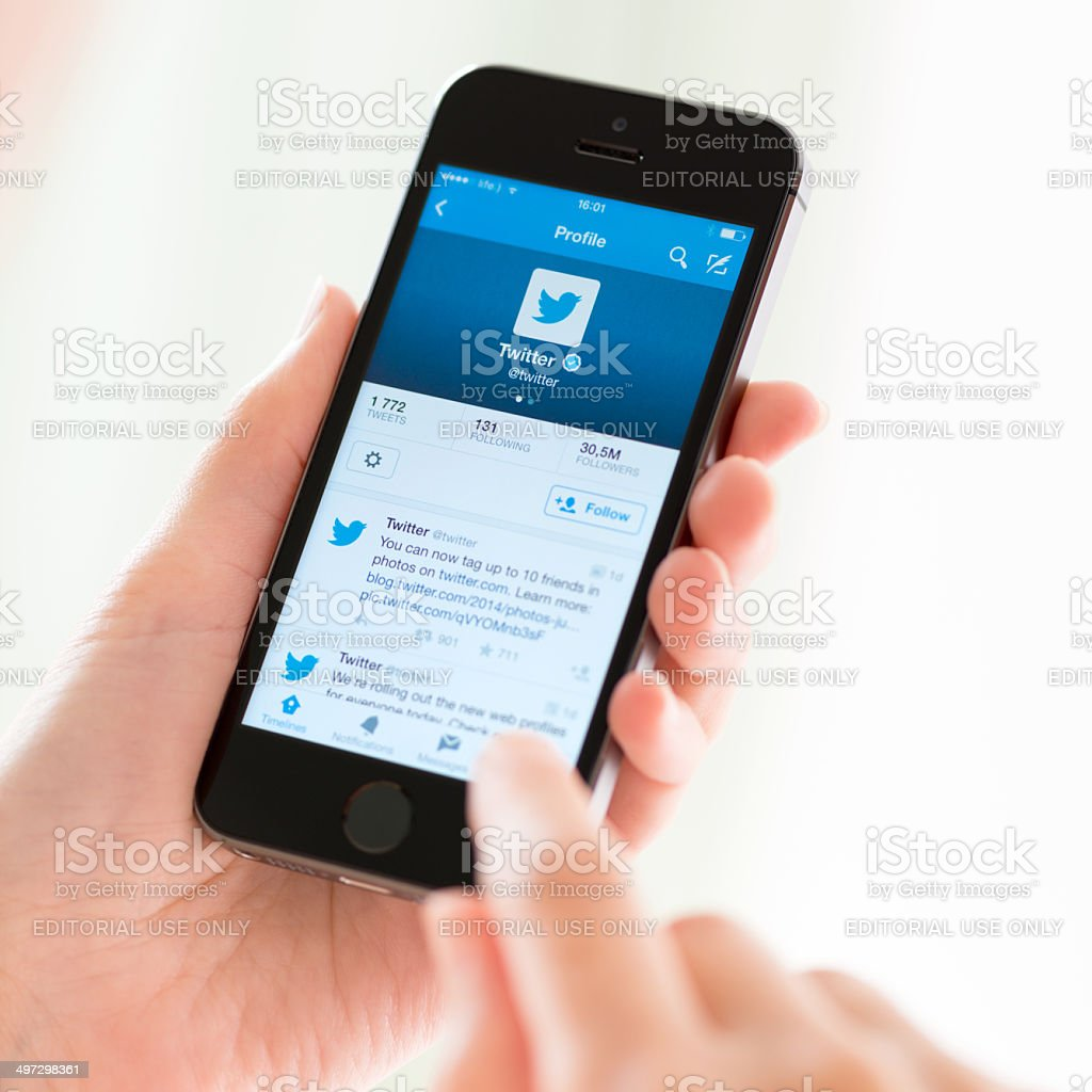 Twitter profile on Apple iPhone 5S stock photo