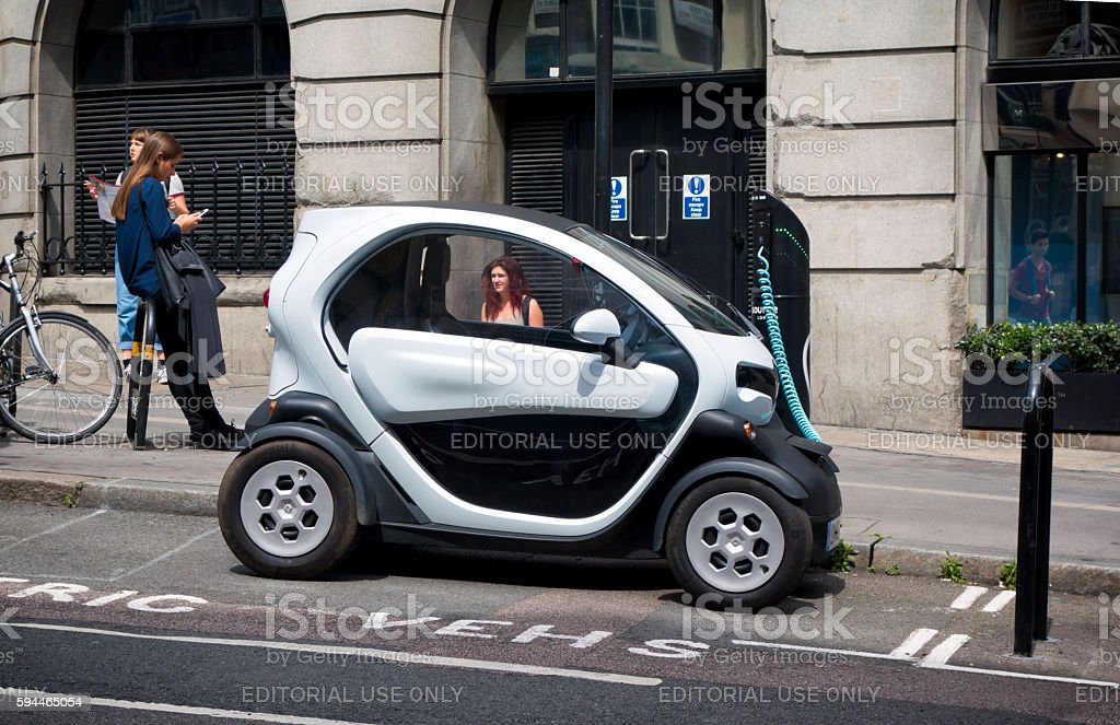 Twizy electric city car recharging in a London street stock photo