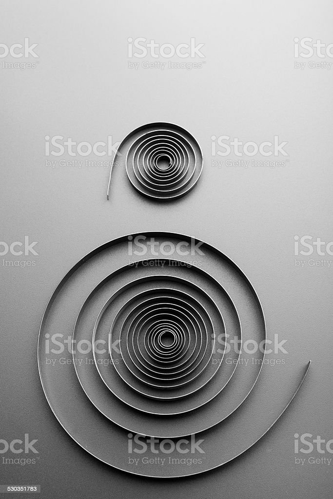 Two abstract metallic spirals stock photo