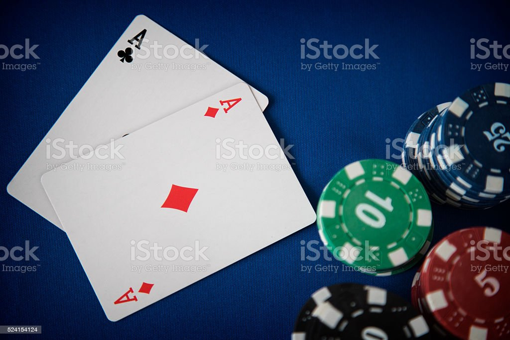 Two aces and gambling chips on casino table stock photo